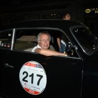 Foto Nicoloro G.  14/05/2015  Rimini     Arriva a Rimini la prima tappa della 33° edizione della 1000 Miglia. La storica competizione partita da Brescia si snoda su un percorso di 1760 chilometri con la partecipazione di 438 vetture e 42 Nazioni. nella foto l' arrivo a Rimini di Cesare Florio, ex pilota ed ex direttore sportivo Ferrari, su una Lancia Aurelia B20 GT 2000 del 1951.
