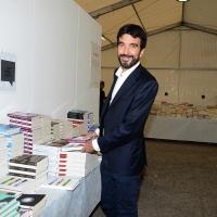 Foto Nicoloro G. 30/08/2018 Ravenna Continua la Festa Nazionale de l' Unita'. nella foto il segretario PD Maurizio Martina, nella libreria della Festa dove compera alcuni libri.