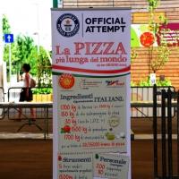 Foto Nicoloro G. 20/06/2015 Milano Realizzata la pizza più lunga del mondo all' Expo 2015. nella foto un cartello specifica gli ingredienti e la loro quantità usati per fare la pizza record.