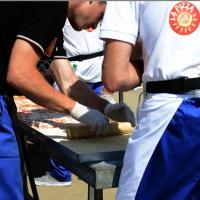Foto Nicoloro G.  20/06/2015  Milano   Realizzata la pizza più lunga del mondo all' Expo 2015. nella foto la delicata operazione della stesura della pasta con un matterello.