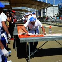 Foto Nicoloro G.  20/06/2015  Milano   Realizzata la pizza più lunga del mondo all' Expo 2015. nella foto la spalmatura della salsa di pomodoro.