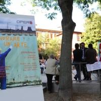 """Foto Nicoloro G. 26/05/2011 Ravenna Con l' intervento del segretario nazionale della CGIL entra nel vivo il festival del lavoro """" Opera Fabbrica - Lavorare e' un' arte """", organizzato dalla camera del Lavoro di Ravenna. nella foto Il Manifesto dell'evento"""