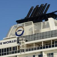 """Foto Nicoloro G. 17/10/2013 Porto Corsini ( Ravenna ) Al terminal di Porto Corsini (RA) è approdata la nave """" The World """", chiamata anche """" il condominio galleggiante """" perchè i 165 croceristi sono anche i proprietari delle lussuose cabine del valore di due milioni di euro. Batte bandiera delle Bahamas e sono queste le sue caratteristiche: 44.000 tonnellate di stazza, lunga 200 metri, alta 30 metri, 12 ponti, 165 appartamenti, 4 bar, 4 ristoranti, piscine, cinema, biblioteca, campo da tennis e da golf, un centro benessere. nella foto La nave """"The World"""", particolare"""