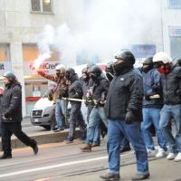 Foto Nicoloro G. Milano 14/12/2010 Corteo degli studenti contro il governo Berlusconi e la riforma Gelmini. Forte tensione con le forze dell' ordine. nella foto Manifestanti resi irriconoscibili dal casco, con fumogeni