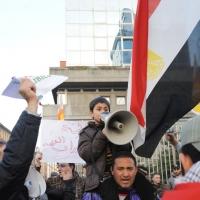 Foto Nicoloro G. 04/03/2011 Milano Manifestazione in piazza Loreto con corteo di un centinaio di immigrati libici contro il regime di Gheddafi a cui hanno partecipato anche immigrati tunisini ed egiziani. nella foto Manifestanti con altoparlante, bandiere e cartelli