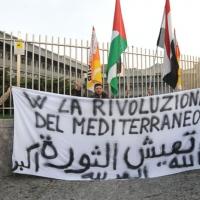 Foto Nicoloro G. 04/03/2011 Milano Manifestazione in piazza Loreto con corteo di un centinaio di immigrati libici contro il regime di Gheddafi a cui hanno partecipato anche immigrati tunisini ed egiziani. nella foto Manifestanti con grande striscione