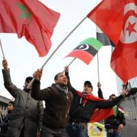 Foto Nicoloro G. 04/03/2011 Milano Manifestazione in piazza Loreto con corteo di un centinaio di immigrati libici contro il regime di Gheddafi a cui hanno partecipato anche immigrati tunisini ed egiziani. nella foto Manifestanti con bandiere