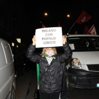 Foto Nicoloro G. 04/03/2011 Milano Manifestazione in piazza Loreto con corteo di un centinaio di immigrati libici contro il regime di Gheddafi a cui hanno partecipato anche immigrati tunisini ed egiziani. nella foto Manifestante con cartello