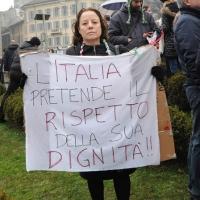 """Foto Nicoloro G. 13/02/2011 Milano Manifestazione delle donne """" Se non ora quando ? """" per la dignita' del soggetto donna e contro Berlusconi. nella foto Manifestante con cartello di protesta"""