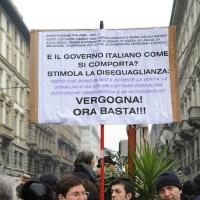 """Foto Nicoloro G. 13/02/2011 Milano Manifestazione delle donne """" Se non ora quando ? """" per la dignita' del soggetto donna e contro Berlusconi. nella foto Manifestanti con cartello di protesta"""