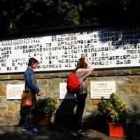 Foto Nicoloro G.   25/04/2014  Marzabotto ( Bologna )   Si celebra nella cittadina medaglia d' oro al Valore Militare la Festa della LIberazione con la partecipazione del presidente della Camera. nella foto la lapide con le foto e i nomi delle vittime della strage.