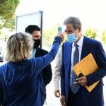 Foto Nicoloro G.   21/08/2020   Rimini    Quarta giornata del Meeting di CL 2020, che in questa edizione ha per titolo ' Privi di meraviglia, restiamo sordi al sublime '. nella foto il governatore della Sicilia Nello Musumeci al controllo del termoscanner.