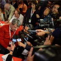 FFoto Nicoloro G.  07/05/2014  Rimini     Seconda giornata del 17° Congresso della CGIL. nella foto Maurizio Landini dopo il suo accalorato intervento circondato dai giornalisti.