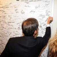 """Foto Nicoloro G. Rimini 04/12/2010 Seconda edizione del """" Salone della Giustizia """" che si svolge dal 02 al 05 dicembre alla Fiera di Rimini. nella foto Ignazio La Russa firma il cartellone degli ospiti"""