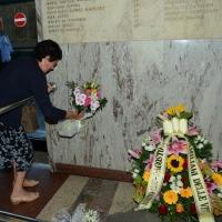Foto Nicoloro G.  02/08/2015   Bologna   Trentacinquesimo anniversario della strage alla stazione di Bologna. nella foto una donna pone un mazzo di fiori sotto la lapide che ricorda le vittime della strage.